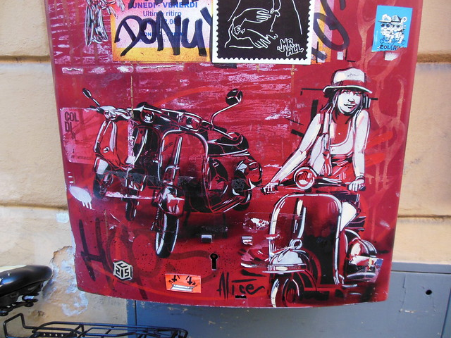 Roma Trastevere Alice Pasquini-C215 & Alice Artwork on Postal Box (Vespa Girl) - Rome, Italy - Courtesy of and pictured by Ittmust - Click here to see the original.