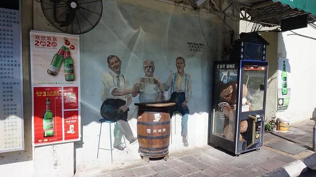 Street art - Men Drinking Beer - Ipoh, Perak, Malaysia.