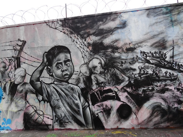 Street Art - Across the sea and across the barbed wire - Rue ordener, Paris, France. Mural by Lask - Courtesy of and pictured by Jeanne Menjoulet  - Click here to see the original