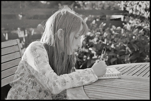 Girl doing a crossword puzzle. Courtesy of Paul Morris aka Paul of Congleton @ www.flickr.com